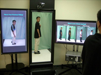 Wei Zhang tests the Responsive Mirror for clothing that he developed with Takashi Matsumoto.